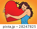 Beautiful young woman hugging Valentine heart 28247825