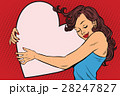 Beautiful young woman hugging Valentine heart 28247827
