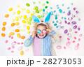 Child on Easter egg hunt. Pastel rainbow eggs. 28273053