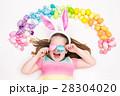 Child on Easter egg hunt. Pastel rainbow eggs. 28304020