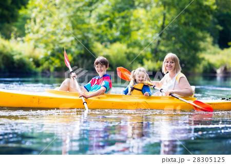 Family enjoying kayak ride on a river 28305125
