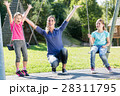 Family on playground swing 28311795