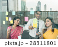 Indian employees sticking reminders on glass wall  28311801