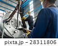 Workers handling equipment for lifting boilers 28311806