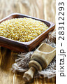 Uncooked bulgur in wooden bowl and scoop. 28312293