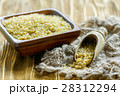 Wooden scoop with bulgur. 28312294