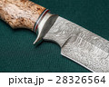 Hunting damascus steel knife on a green fabric 28326564