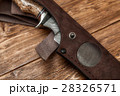 Hunting damascus steel knife on wooden background 28326571
