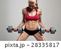fitness athletic woman pumping up muscles.gym girl 28335817