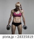 fitness athletic woman pumping up muscles.gym girl 28335819