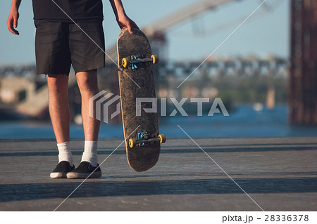 Guy with a skateboard. 28336378