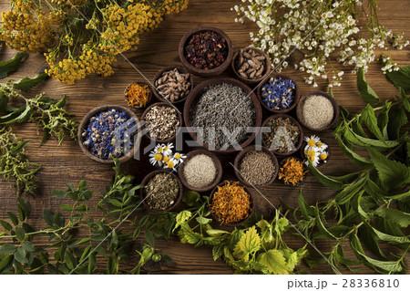 Alternative medicine, dried herbs and mortar 28336810