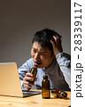 残業 ビジネスマン 疲労の写真 28339117
