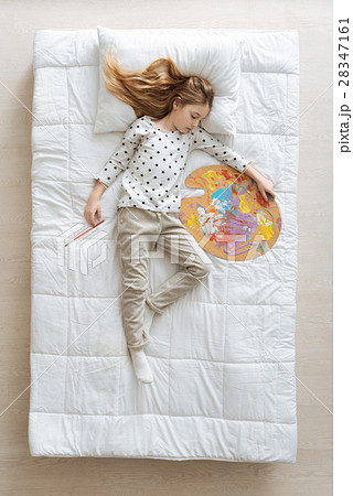 Cute young artist having a napの写真素材 [28347161] - PIXTA