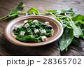 Spinach with cheese, olives 28365702