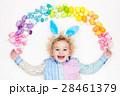 Child on Easter egg hunt. Pastel rainbow eggs. 28461379
