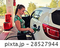 Young woman fills her car with benzine 28527944