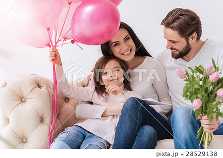 Cute happy girl holding balloons 28529138
