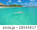 Woman floating on a back in the beautiful sea 28543617