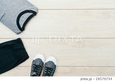 T-shirt with pants and shoes on wooden backgroundの写真素材 [28570734] - PIXTA