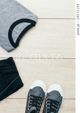 T-shirt with pants and shoes on wooden backgroundの写真素材 [28572154] - PIXTA