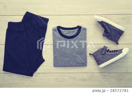 T-shirt with pants and shoes on wooden backgroundの写真素材 [28572781] - PIXTA