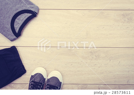 T-shirt with pants and shoes on wooden backgroundの写真素材 [28573611] - PIXTA