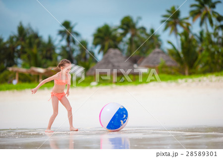 Cute little girl playing with ball on beach, kids 28589301