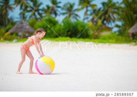 Cute little girl playing with ball on beach, kids 28589307