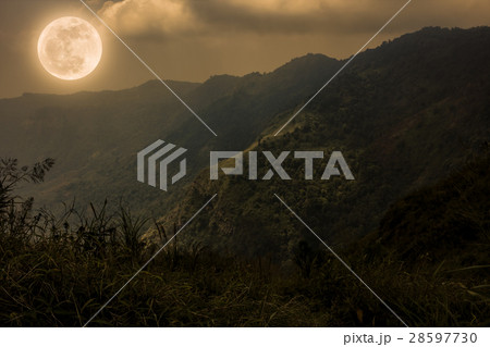Mountain peaks with sky and beautiful full moon.  28597730