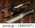 Steel knives, flashlight and gun 28603971