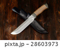 Hunting knife handmade on a wooden background 28603973