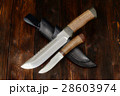 Hunting knives handmade on a wooden background 28603974