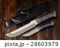 Hunting knives handmade on a wooden background 28603979