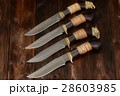 Damascus knives handmade on a wooden background 28603985