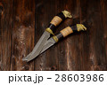 Damascus knives handmade on a wooden background 28603986