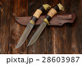 Damascus knives handmade on a wooden background 28603987