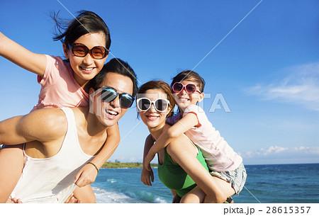 Happy Family Having Fun at the Beach 28615357