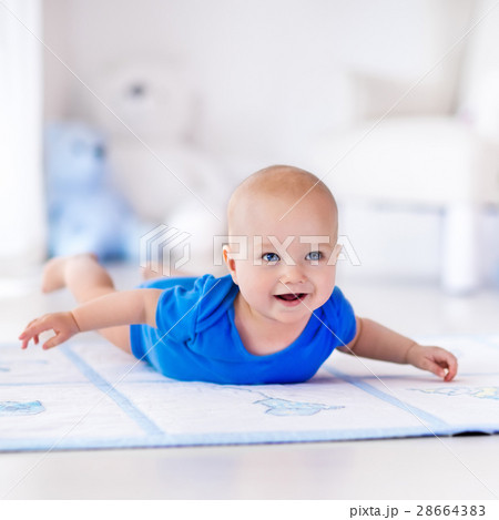 Baby boy playing and learning to crawl 28664383