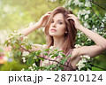Beautiful Woman with Spring Flowers in Sunlight 28710124