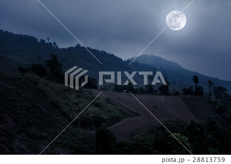 Mountain peaks with blue sky and full moon. 28813759