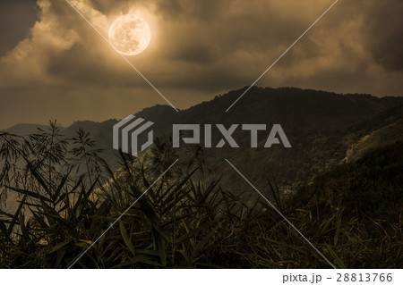 Mountain peaks with sky and full moon. Sepia color 28813766