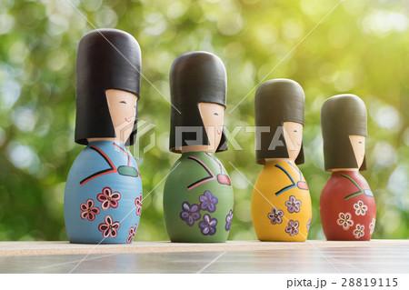 Japanese Kokeshi Dolls with green bokeh backgroundの写真素材 [28819115] - PIXTA