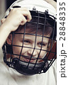 Little boy in the hockey helm. Emotions of child.  28848335