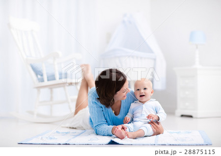 Mother and baby playing on the floor 28875115