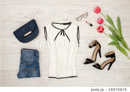 Fashion concept. White blouse, blue handbag, jeansの写真素材 [28970876] - PIXTA