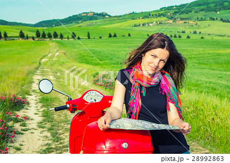Young woman traveling by a scooter 28992863