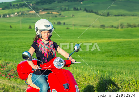 Young woman traveling by a scooter 28992874