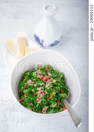 Quinoa tabbouleh salad on a wooden tableの写真素材 [29000115] - PIXTA