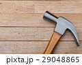 Hammer on wood background with copy space 29048865